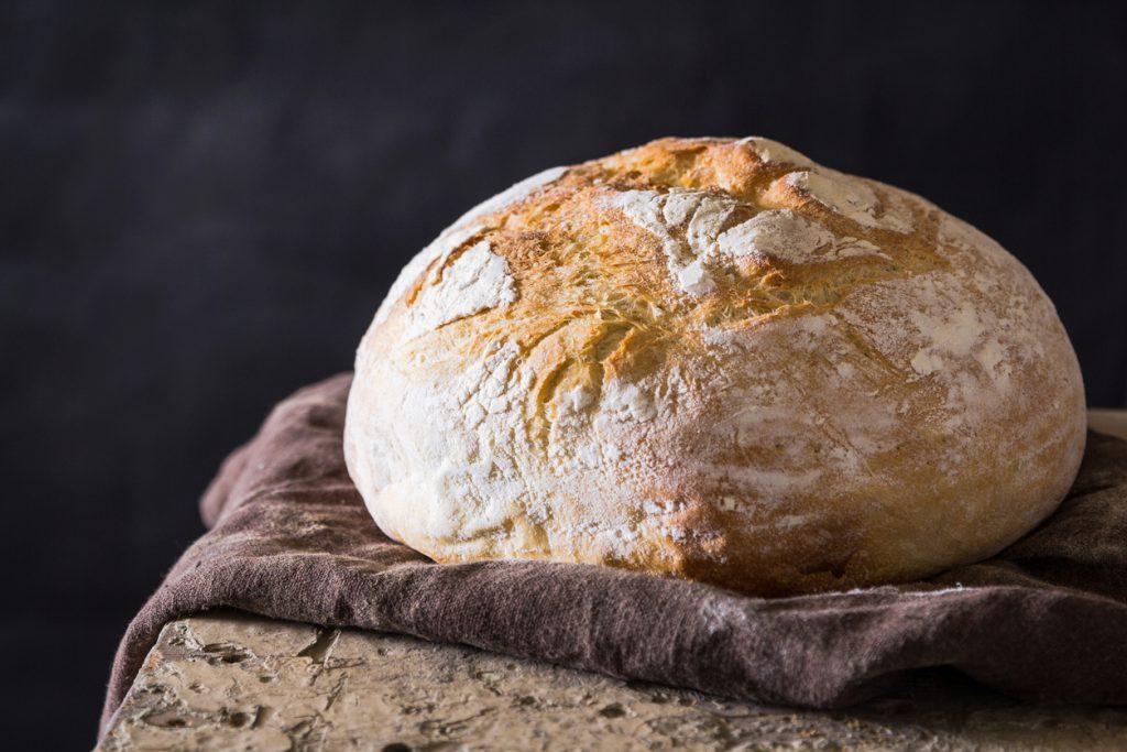 A freshly baked loaf against a dark background