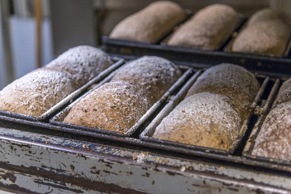 Artisan loaves of bread on calling rack.